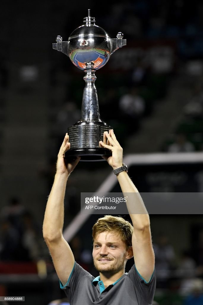 David Goffin of Belgium holds the trophy during the awarding ceremony after their men's singles final match against Adrian Mannarino of France during the Japan Open tennis tournament in Tokyo on October 8, 2017. / AFP PHOTO / Toru Yamanaka