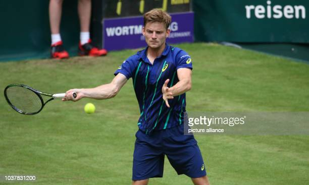 David Goffin of Belgium in action against Borna Coric of Croatia during his first round match at the ATPtennis tournament in Halle Germany 13 June...