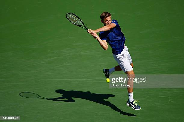 David Goffin of Belgium in action against Milos Raonic of Canada in the semi finals during day thirteen of the BNP Paribas Open at Indian Wells...