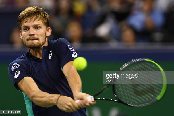 David Goffin of Belgium in action against Roger Federer of Switzerland on day six of 2019 Rolex Shanghai Masters at Qi Zhong Tennis Centre on October...