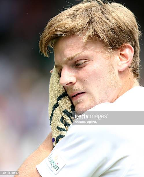 David Goffin of Belgium is seen his Gentlemen's Singles first round match against Andy Murray of Great Britain during the Wimbledon Lawn Tennis...