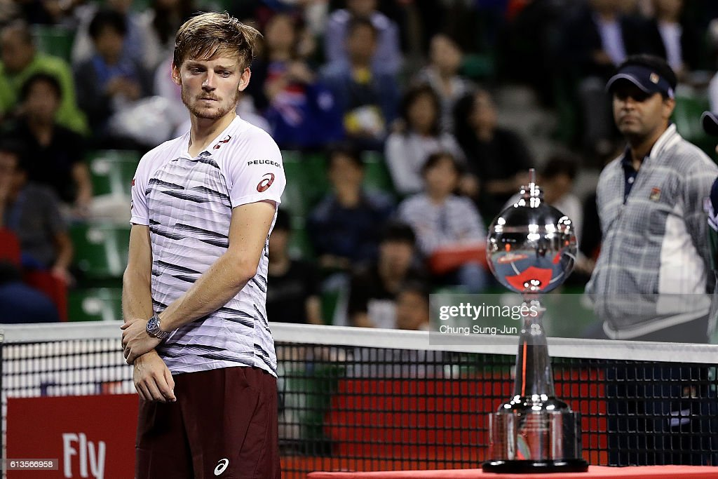 David Goffin of Belgium looks at winner's trophy after losing the men's singles final match against Nick Kyrgios of Australia on day seven of Rakuten Open 2016 at Ariake Colosseum on October 9, 2016 in Tokyo, Japan.