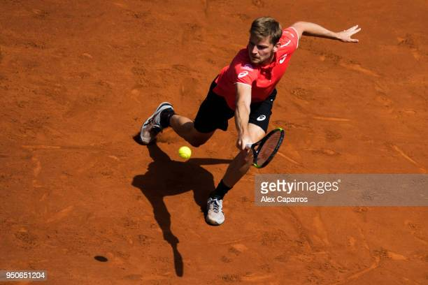 David Goffin of Belgium plays a backhand against Marcel Granollers of Spain in their match during day three of the Barcelona Open Banc Sabadell on...