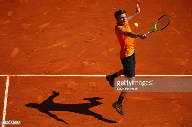 David Goffin of Belgium plays a backhand against Steve Darcis of Belgium in their first round match on day one of the Monte Carlo Rolex Masters at...