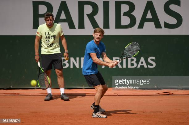 David Goffin of Belgium plays a backhand in front of his coach Thierry Van Cleemput during a practice session ahead of the French Open at Roland...