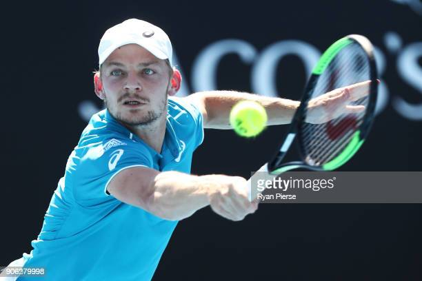 David Goffin of Belgium plays a backhand in his second round match against Julien Benneteau of France on day four of the 2018 Australian Open at...