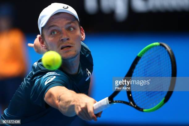 David Goffin of Belgium plays a backhand in his singles match against Vasek Pospisil of Canada on day seven during the 2018 Hopman Cup at Perth Arena...