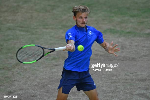 David Goffin of Belgium plays a forehand in his match against Alexander Zverev of Germany during day 5 of the Noventi Open at Gerry Weber Stadium on...