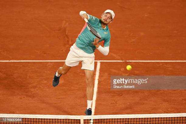David Goffin of Belgium plays an overhead shot during his Men's Singles first round match against Jannik Sinner of Italy during day one of the 2020...
