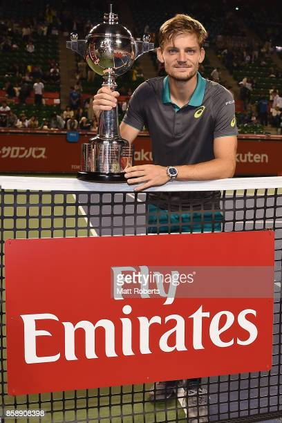David Goffin of Belgium poses with the winners trophy after his men's final match against Adrian Mannarino of France during day seven of the Rakuten...