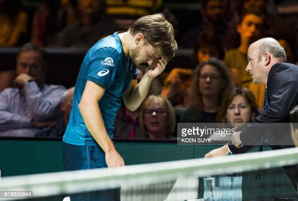 David Goffin of Belgium reacts after an injury during his semifinal singles match against Grigor Dimitrov of Bulgaria for the ABN AMRO World Tennis...