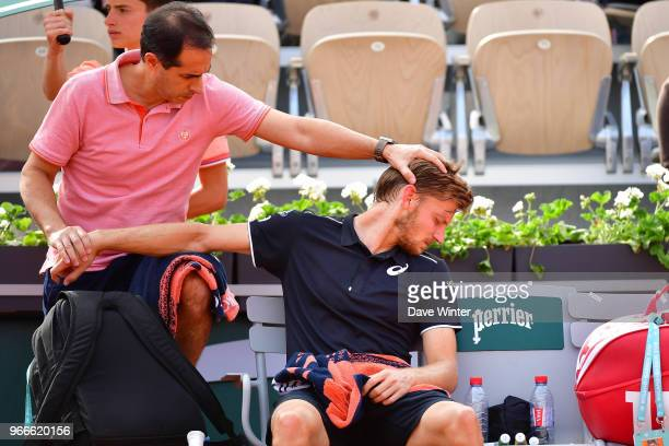 David Goffin of Belgium receives treatment from the physio during Day 8 of the French Open 2018 on June 3 2018 in Paris France