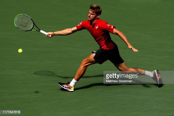 David Goffin of Belgium returns a shot during his Men's Singles fourth round match against Roger Federer of Switzerland on day seven of the 2019 US...