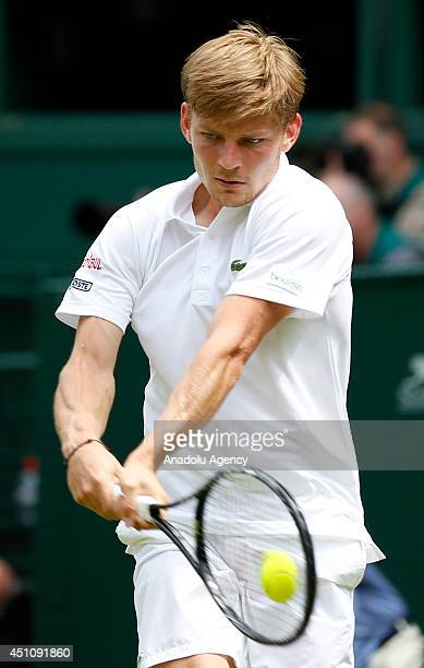 David Goffin of Belgium returns the ball during his Gentlemen's Singles first round match against Andy Murray of Great Britain during the Wimbledon...