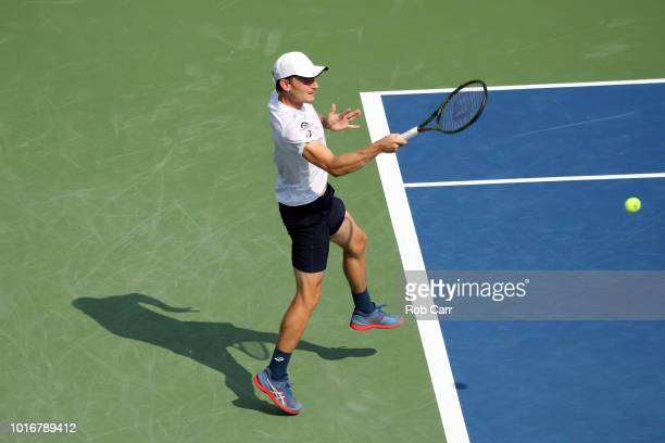 David Goffin of Belgium returns the ball to Stefanos Tsitsipas of Greece during Day 4 of the Western and Southern Open at the Lindner Family Tennis...