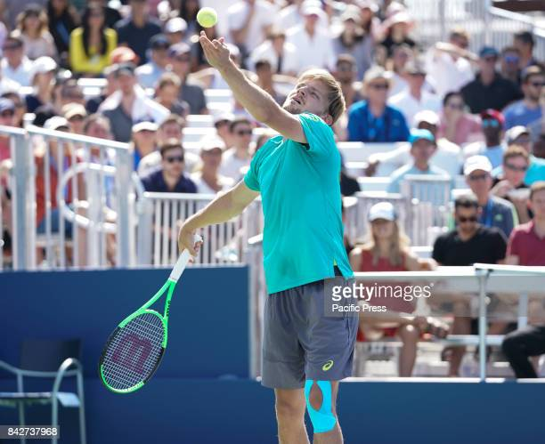 David Goffin of Belgium serves during match against Andrey Rublev of Russia at US Open Championships at Billie Jean King National Tennis Center