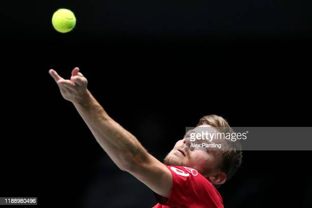 David Goffin of Belgium serves in his Davis Cup Group Stage match against Alex De Minaur of Australia during Day Three of the 2019 David Cup at La...