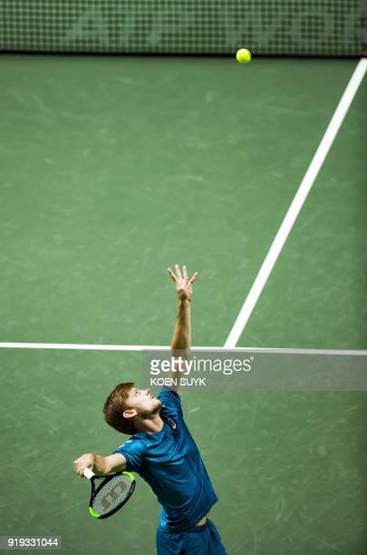 David Goffin of Belgium serves to Grigor Dimitrov of Bulgaria during their semifinal singles match for the ABN AMRO World Tennis Tournament in...