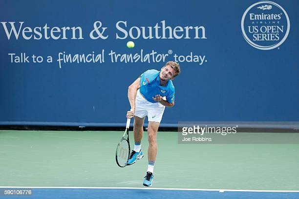 David Goffin of Belgium serves to Nikoloz Basilashvili of Georgia during the first round of play on Day 4 of the Western Southern Open at the Lindner...