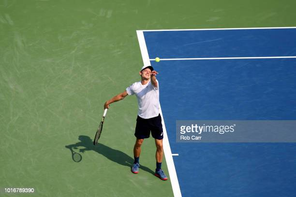 David Goffin of Belgium serves to Stefanos Tsitsipas of Greece during Day 4 of the Western and Southern Open at the Lindner Family Tennis Center on...