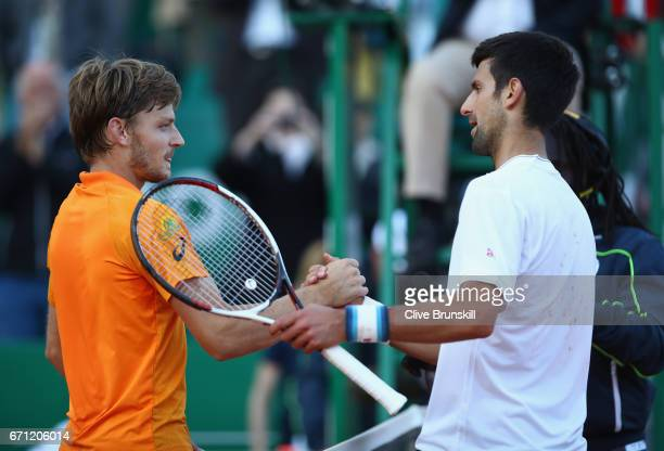 David Goffin of Belgium shakes hands at the net after his three set victory against Novak Djokovic of Serbia in their quarter final round match on...