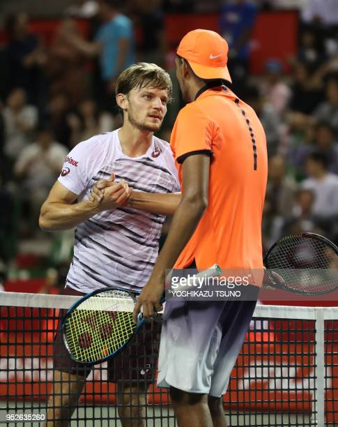 David Goffin of Belgium shakes hands with Nick Kyrgios of Australia in the final of the Rakuten Japan Open tennis championships in Tokyo on October 9...