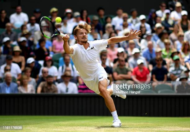 David Goffin of Belgium stretches to play a forehand in his Men's Quarter Final match against Novak Djokovic of Serbia during Day Nine of The...