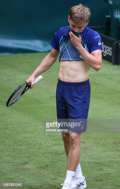David Goffin of Belgium wipes his face during his first round match against Borna Coric of Croatia at the ATPtennis tournament in Halle Germany 13...