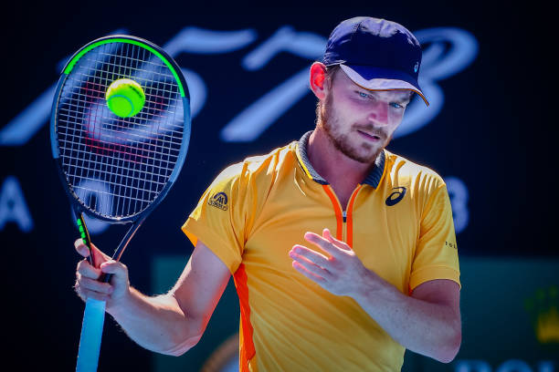David Goffin reacts during a tennis match between Belgian Goffin and Australian Popyrin, in the first round of the men's singles competition of the...