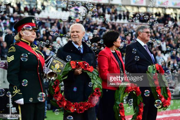 David Gold, Chairman of West Ham United holds a poppy wreath for Armistice day prior to the Premier League match between West Ham United and Burnley...