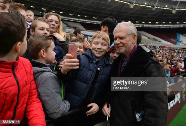 David Gold, Joint Chairman of West Ham United poses for pictures with fans during a West Ham United family fun day at London Stadium on February 15,...