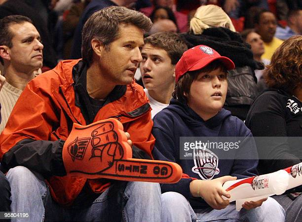 David Goldman and his son Sean attend an NBA game between the New Jersey Nets and the Indiana Pacers at the Izod Center on January 15 2010 in East...