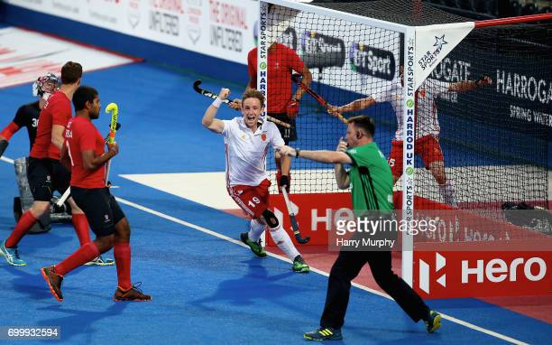 David Goodfield of England celebrates scoring his teams third goal during the quarter final match between England and Canada on day seven of the Hero...