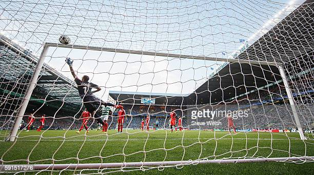 David Goresh of Hapoel fails to stop the free kick by Leigh Griffiths of Celtic during the UEFA Champions League Playoff First leg match between...