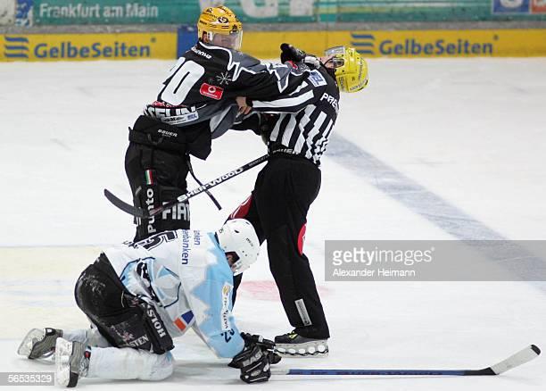 David Gosselin of Frankfurt hits the referee while Beboit Gratton of Hamburg lies on the ground during the DEL Bundesliga match between Frankfurt...