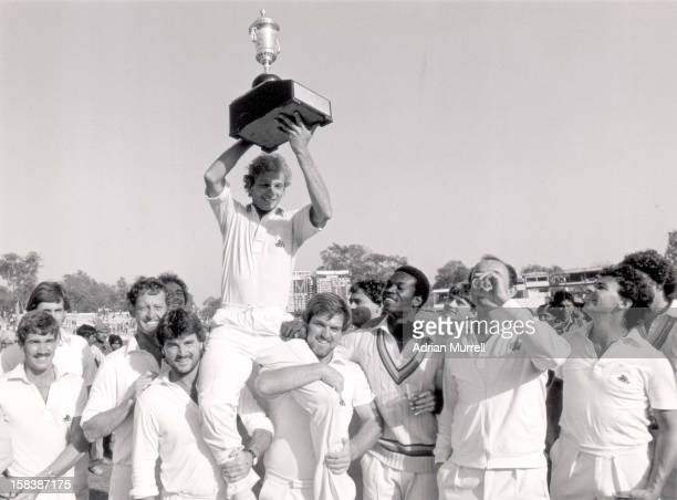 David Gower of England holds the trophy aloft after the Fifth Test against India at Green Park in Kanpur India The match ended in a draw