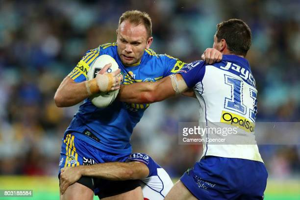 David Gower of the Eels is tackled during the round 17 NRL match between the Parramatta Eels and the Canterbury Bulldogs at ANZ Stadium on June 29...