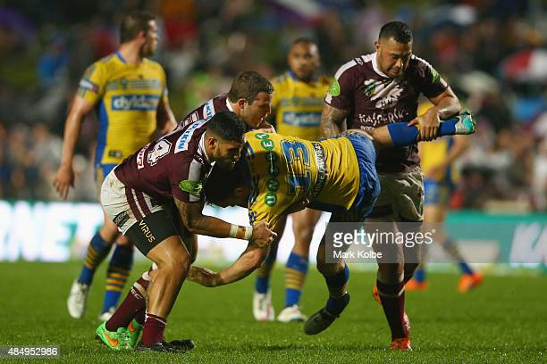 David Gower of the Eels is tackled during the round 24 NRL match between the Manly Warringah Sea Eagles and the Parramatta Eels at Brookvale Oval on...