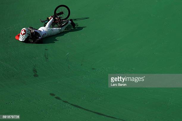 David Graf of Switzerland crashes in the Cycling BMX Men's Quarterfinals on Day 13 of the 2016 Rio Olympic Games at Olympic BMX Centre on August 18...