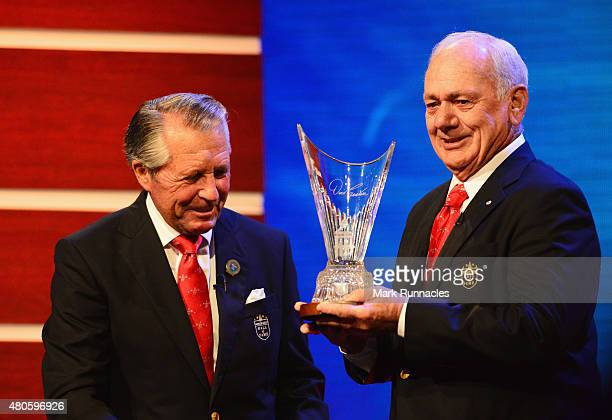 David Graham stands on stage alongside Gary Player as he is inducted into the World Golf Hall of Fame at St Andrews University on July 13 2015 in St...