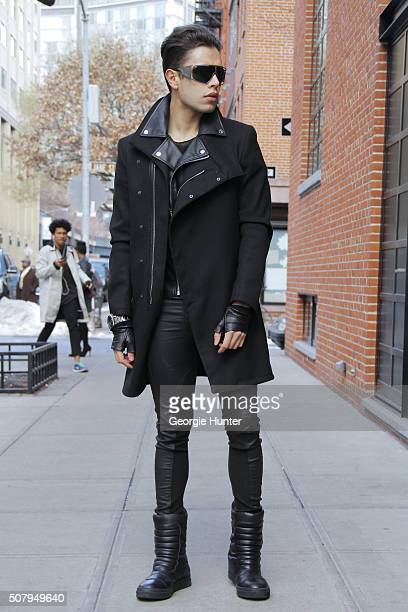 David Granados seen at Industria Superstudios wearing black Topman snow boots black leather Skingraft pants black Armani vest sunglasses and silver...