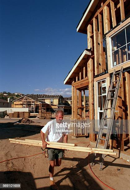 PHOTO––– David Granger works on one of many single family homes under construction at Vista Las Palmas located north of Las Posas Rd and west of...