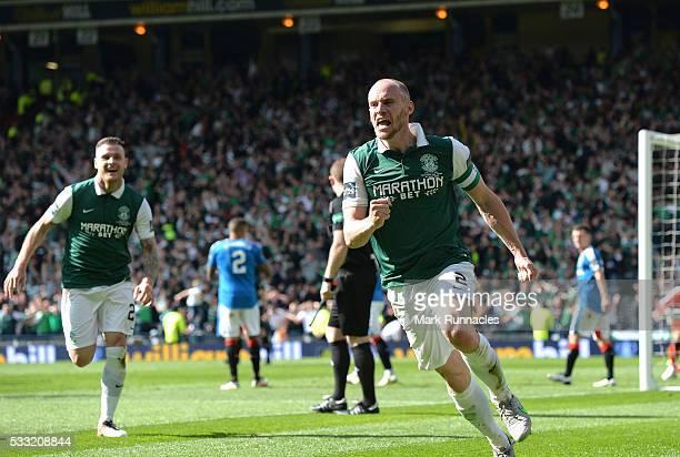 David Gray of Hibernian celebrates scoring the winning goal as Hibernian beat Rangers 32 during the William Hill Scottish Cup Final between Rangers...