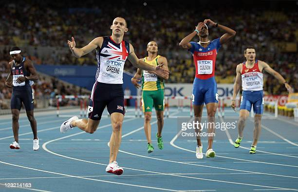 David Greene of Great Britain celebrates after crossing the finish line and claiming gold ahead of Bershawn Jackson of United States, Cornel...