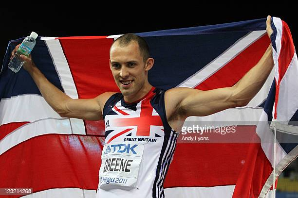 David Greene of Great Britain celebrates with his country's flag after claiming gold in the men's 400 metres hurdles final during day six of the 13th...