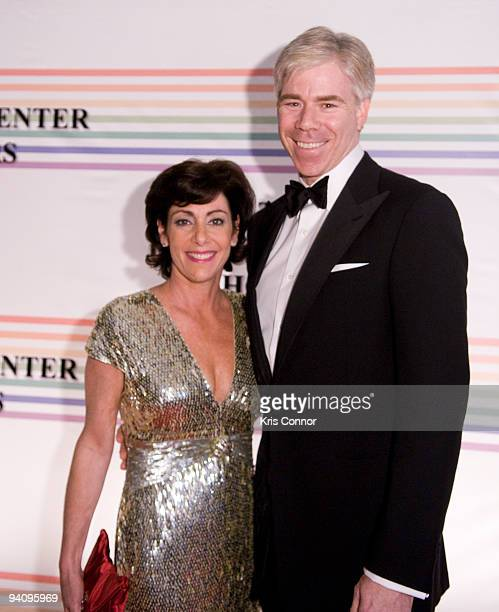 David Gregory and Beth Wilkinson pose for photographers on the red carpet before the 32nd Kennedy Center Honors at Kennedy Center Hall of States on...