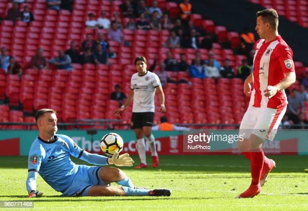 LR David Gregory of Bromley saves from Aaron Williams of Brackley Town during The Buildbase FA Trophy Final match between Brackley Town and Bromley...
