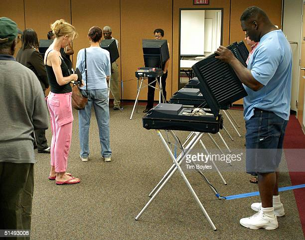 David Griffin uses an electronic machine to cast his ballot on the first day of early voting in the presidential election at the James Weldon Johnson...