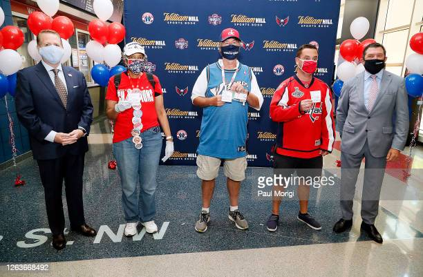 David Grolman , Dave Feldman , Dave Dworkin , Angela Tilghman , and Jim Van Stone pose for a photo as William Hill officially opens first-ever sports...