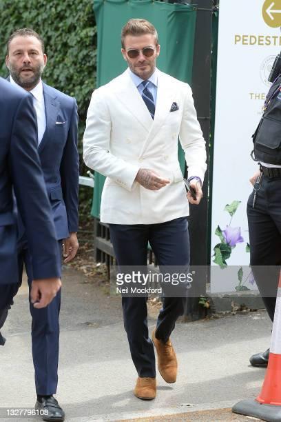 David Grutman and David Beckham attend Wimbledon Championships Tennis Tournament Day 11 at All England Lawn Tennis and Croquet Club on July 09, 2021...